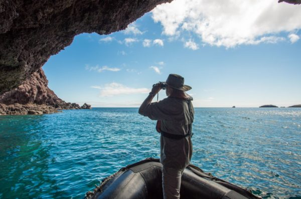 Guest viewing rock formations in the Galapagos Islands.