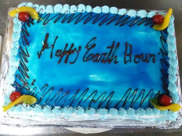 Cake celebrating Earth Hour aboard Santa Cruz II.