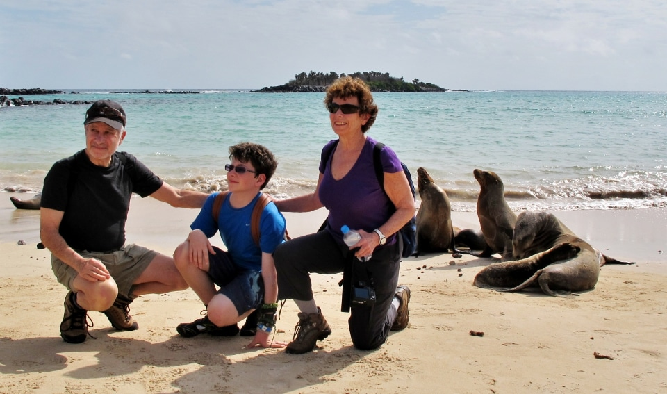 Family photo with sea lions in Galapagos
