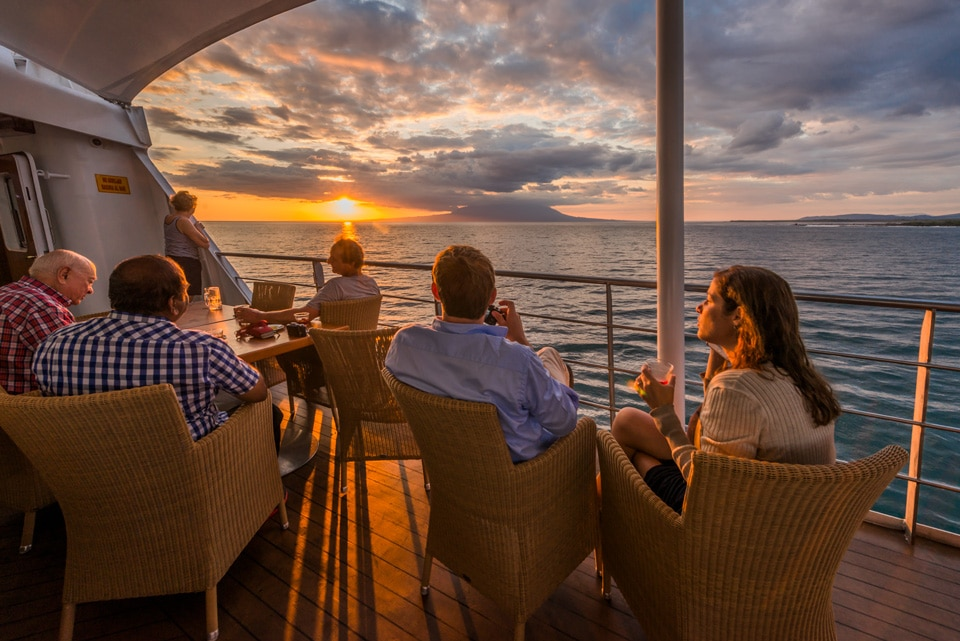 Santa Cruz II Cruise's guests enjoying their gourmet dinner and the sunset.
