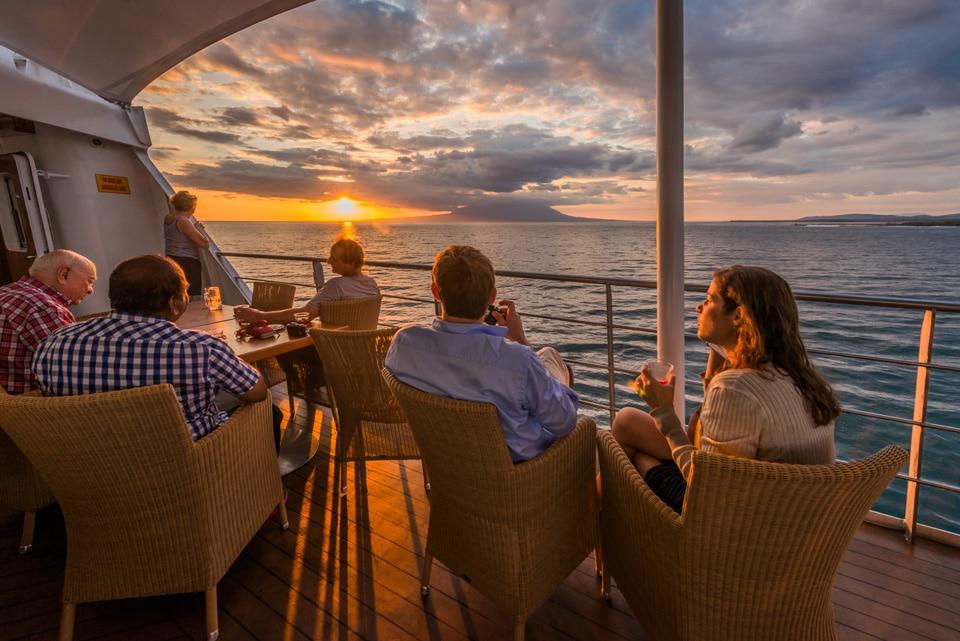 Santa Cruz II Cruise's guests enjoying their gourmet dinner and the sunset.