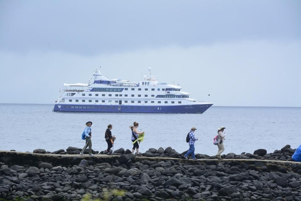 Santa Cruz's guests walking through a trail at Española Island