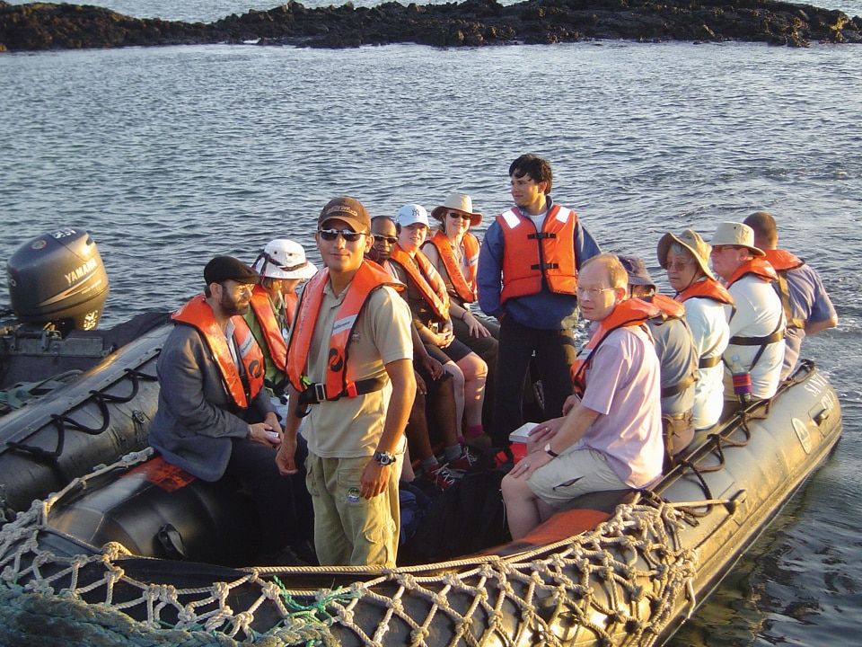 A Galapagos Naturalist Guide with our guests on a panga.
