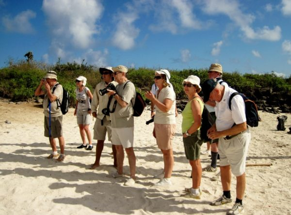 Guests taking photos while exploring the Galapagos Islands.
