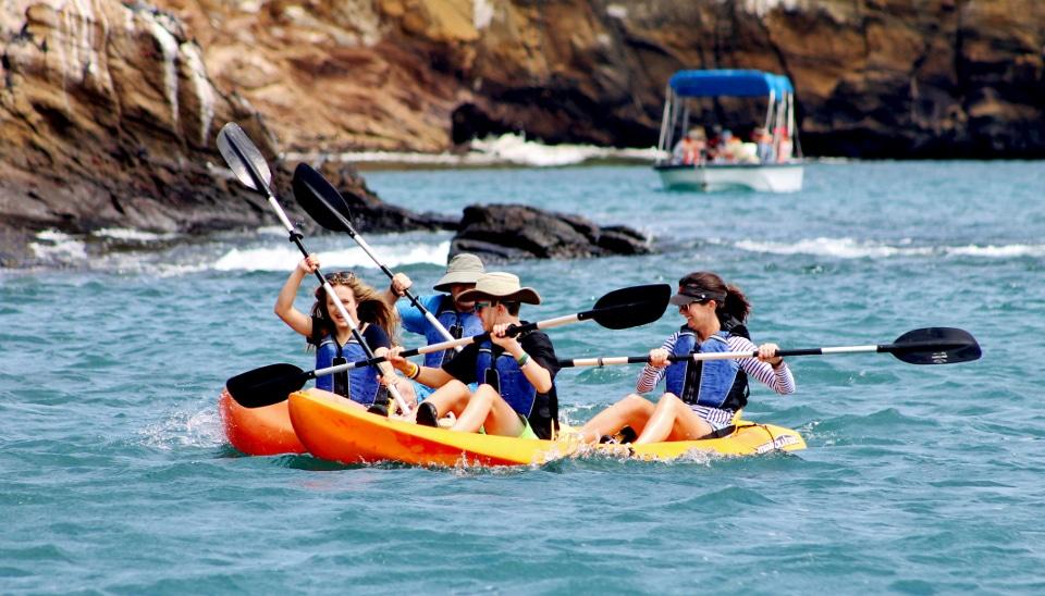 Kayaking and glass-bottom boat aboard Santa Cruz II Galapagos Cruise.