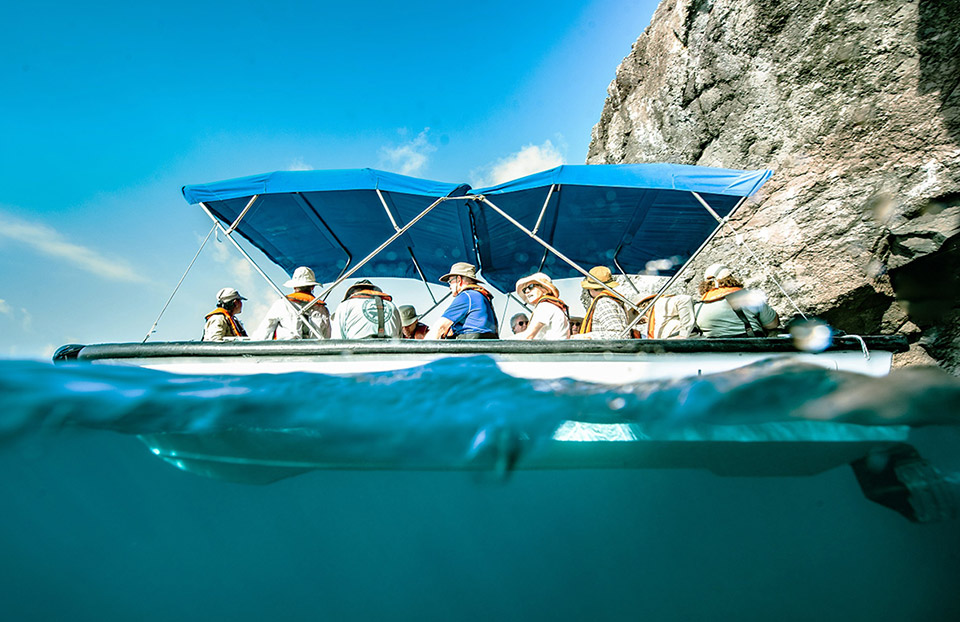 People enjoying the glass-bottom boat aboard Santa Cuz II.
