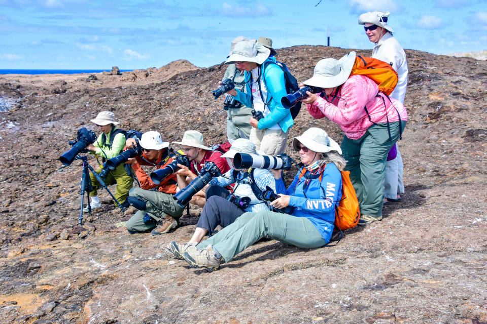 Santa Cruz's guests taking photos in Galapagos.