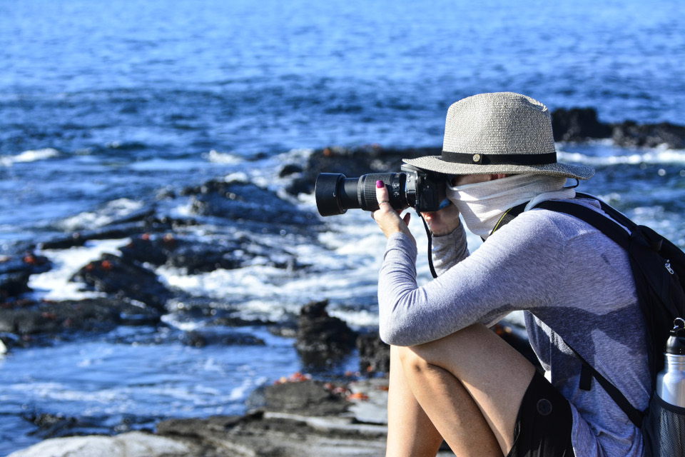 Which Galapagos cruise offers an onboard Expedition Photographer?