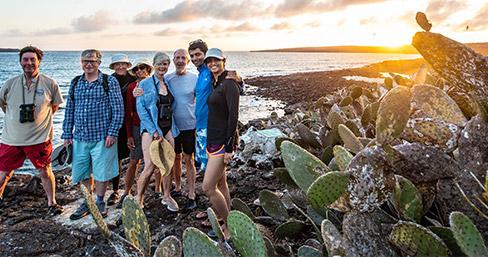 Santa Cruz II's guests hiking at Darwin Bay on Genovesa Island.