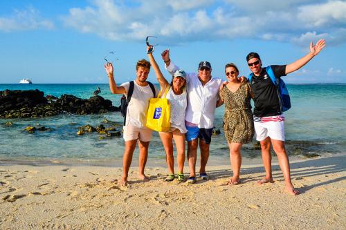 A family enjoying its Galapagos cruise and tour