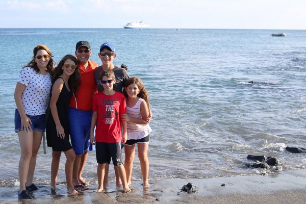 Family in the beach at the Galapagos Islands